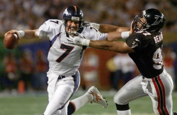 Denver Broncos quarterback and futer Hall of Famer John Elway stiff-arming Falcons linebacker Cornelius Bennett during Super Bowl XXXIII in Miami. (AP Photo/Doug Mills)